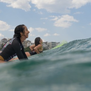 photo-of-women-riding-surfboard-3436517